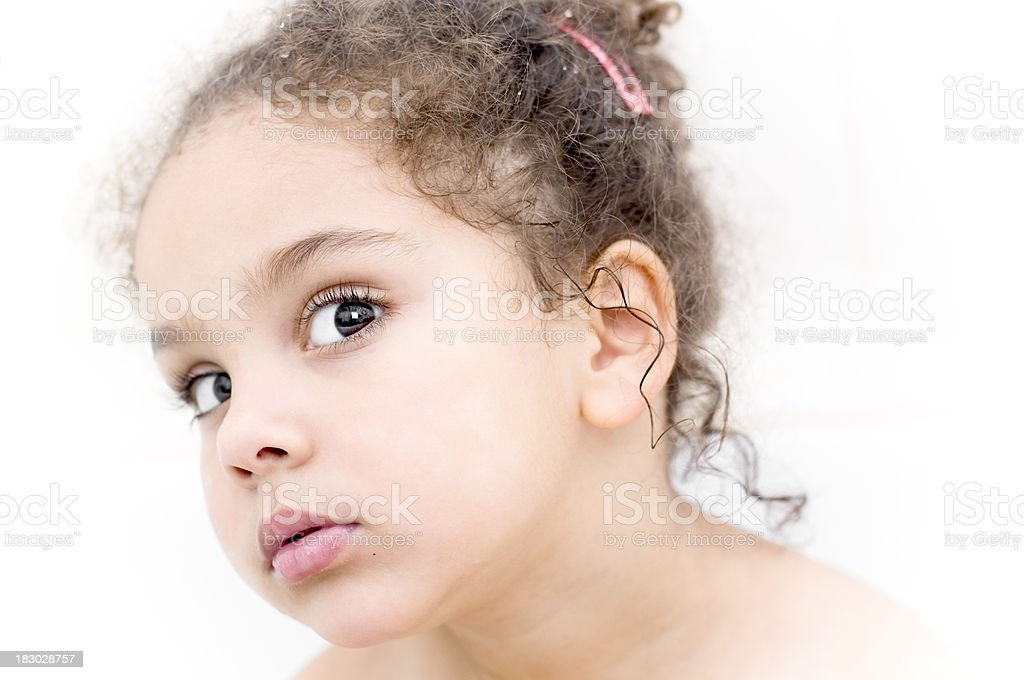 Girl (4-5) Looking serious, White Background royalty-free stock photo