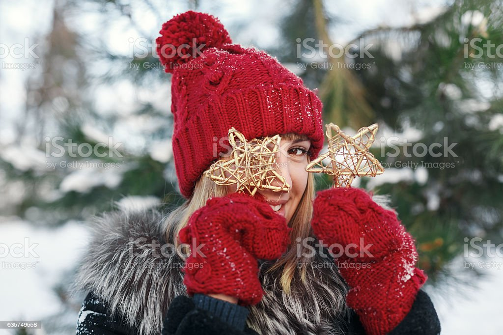 Girl looking through a Christmas toy stock photo