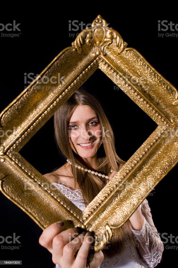 Girl Looking Through A Frame stock photo