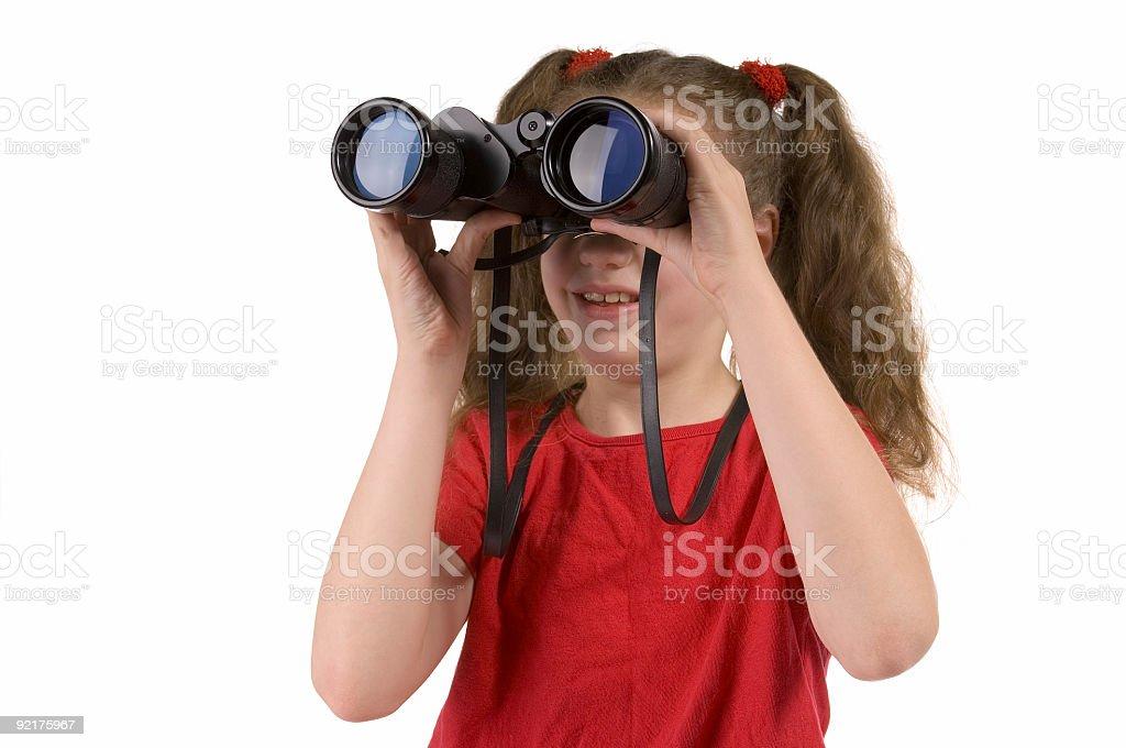 Girl looking through binoculars royalty-free stock photo