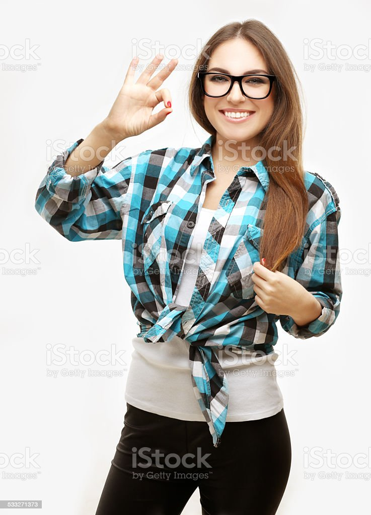 Girl looking through OK sign she made with her hand stock photo