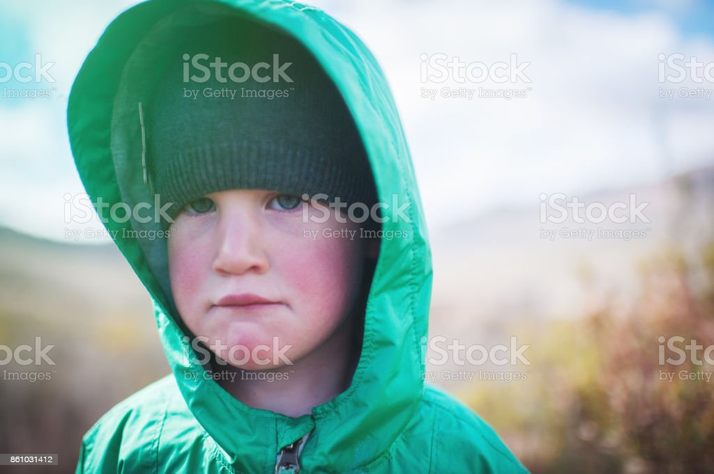 Girl looking tired and sad outdoors stock photo