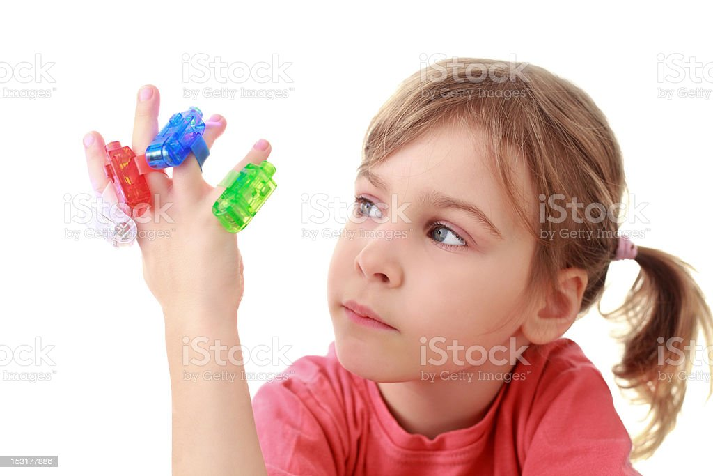 Girl looks at flashlights which are on fingers stock photo