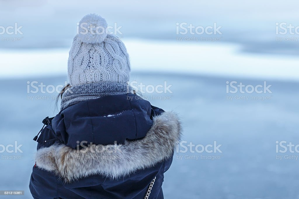 Girl Looks at Winter Lake stock photo