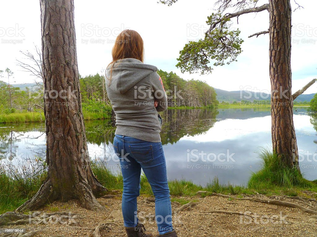 Girl Looks Out Over Loch Garten stock photo