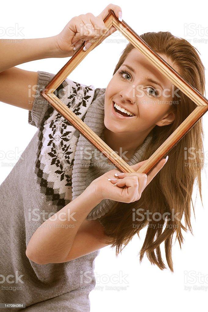 Girl looks through framework royalty-free stock photo
