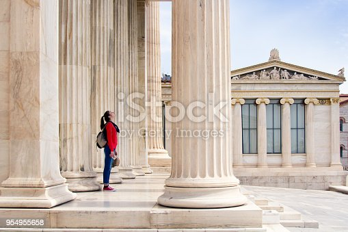 istock A girl looks up at the ceiling, under the columns of the Athenian Academy 954955658