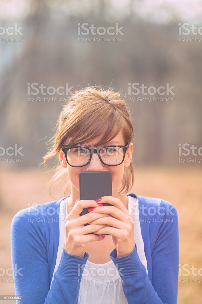 Girl loving her cellphone. foto de stock royalty-free