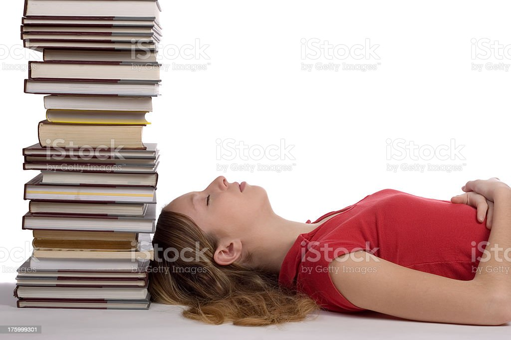 Girl lying by the books royalty-free stock photo