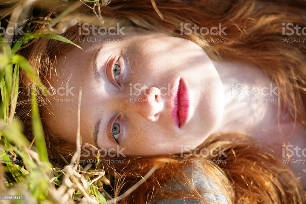 Girl lying in a meadow royalty-free stock photo