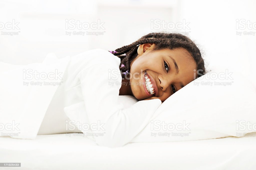 Girl lying in her bed. stock photo
