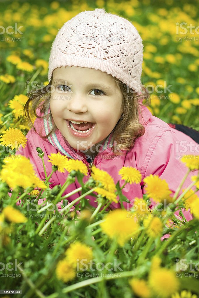 girl lying in the dandelions royalty-free stock photo