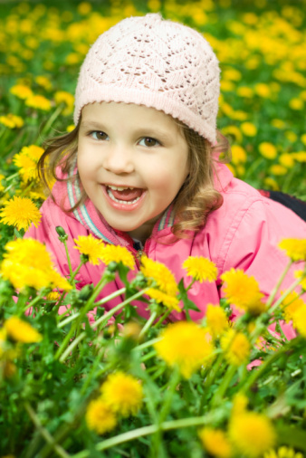 Girl Lying In The Dandelions Stock Photo - Download Image Now