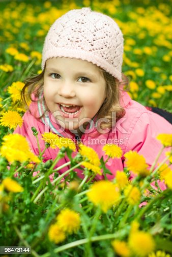 Girl Lying In The Dandelions Stock Photo & More Pictures of Beautiful People