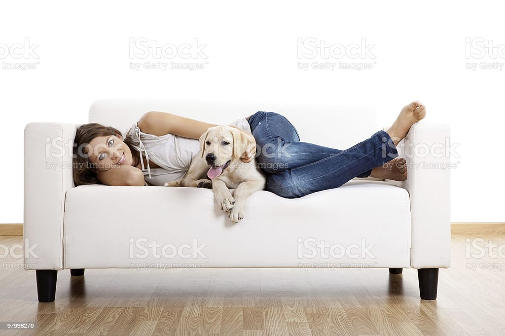Girl lying on a couch with her dog royalty-free stock photo