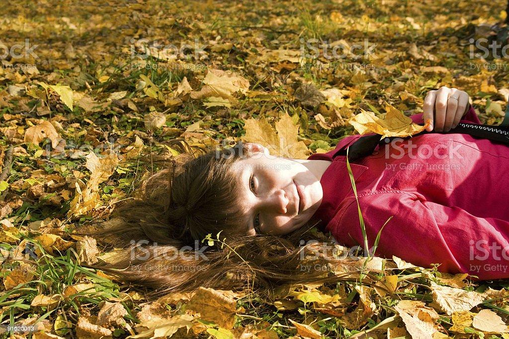 Girl Lying On Leaves  Adult Stock Photo