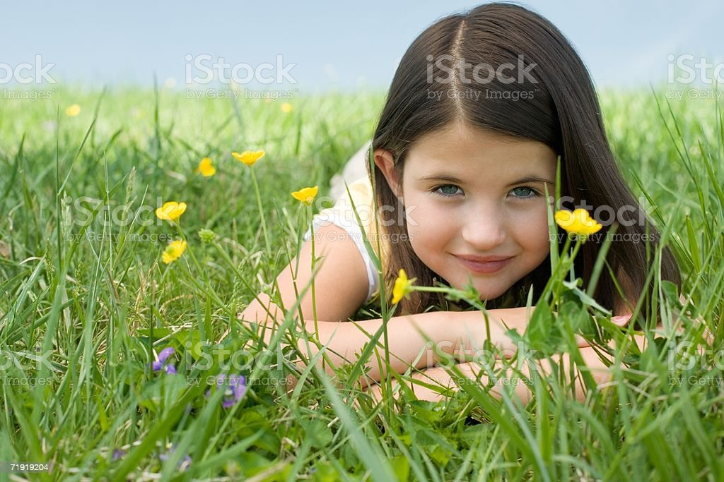 Girl lying on meadow royalty-free stock photo
