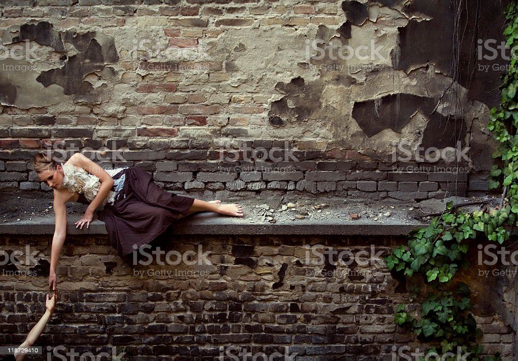 girl lying on the wall stock photo