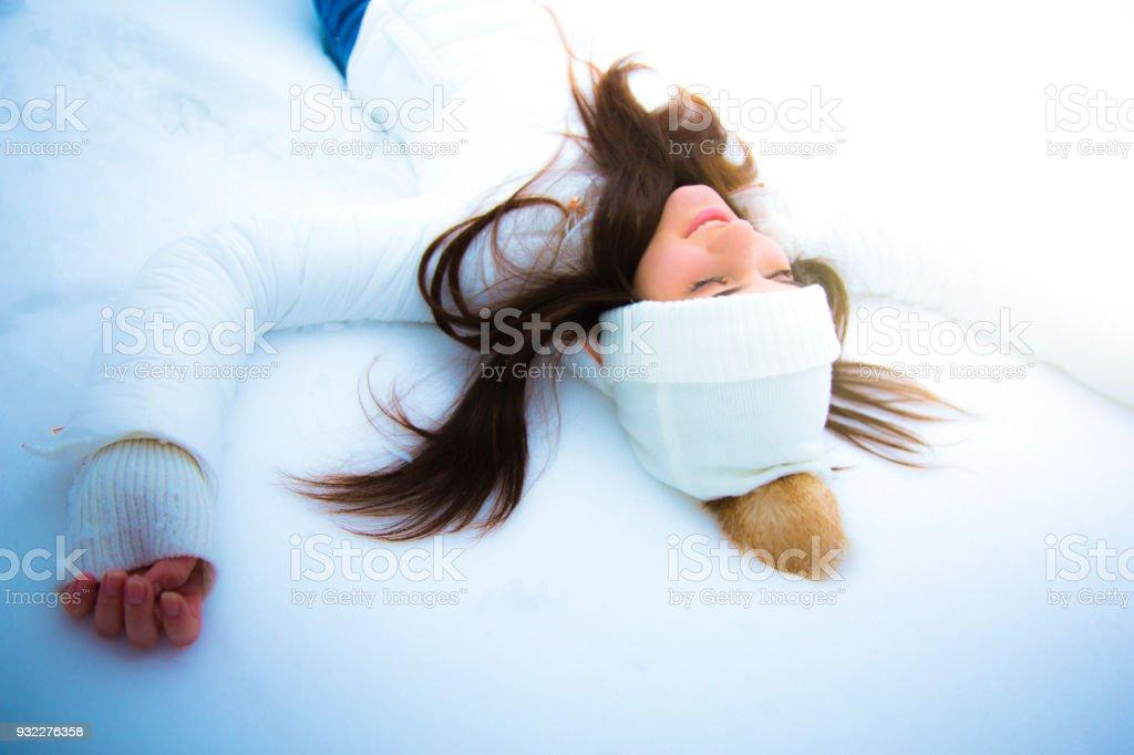 Teenage girl in white enjoying winter