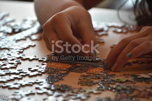 A girl makes a puzzle