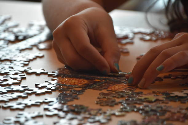 A girl makes a puzzle stock photo