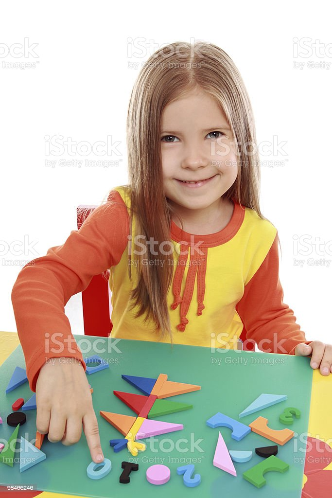 Girl makes Christmas applique royalty-free stock photo