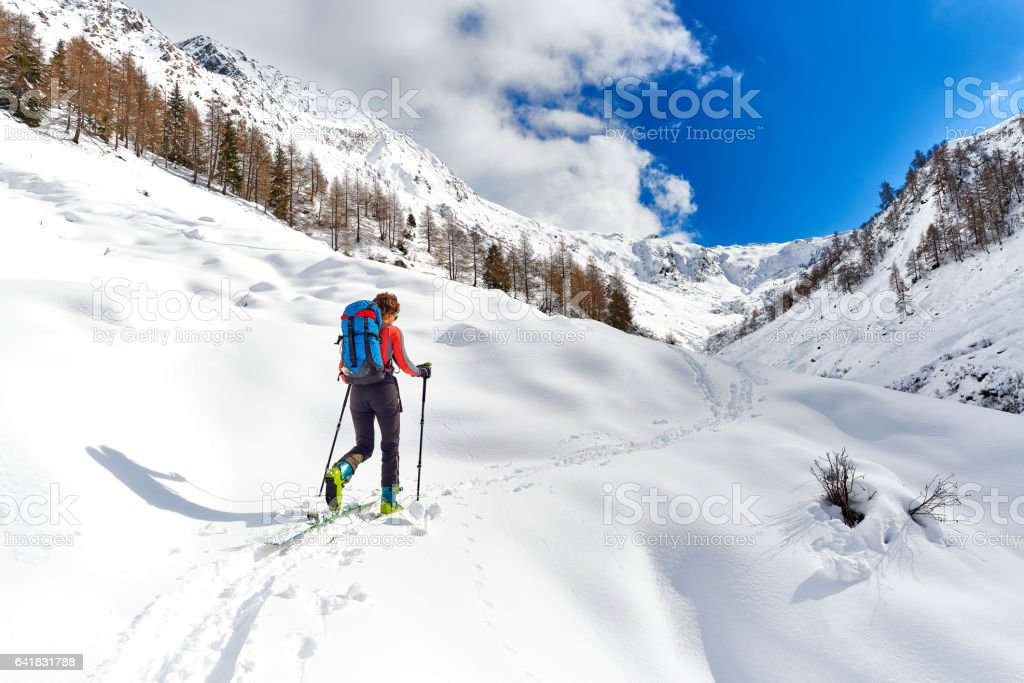 Girl makes ski mountaineering alone stock photo