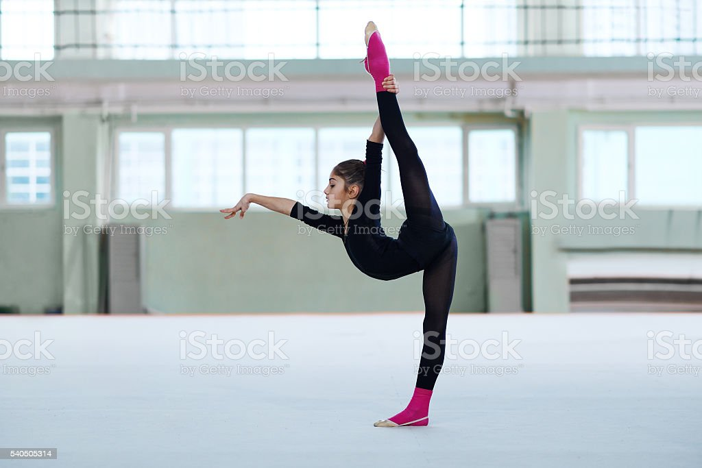 girl making a balance in training stock photo