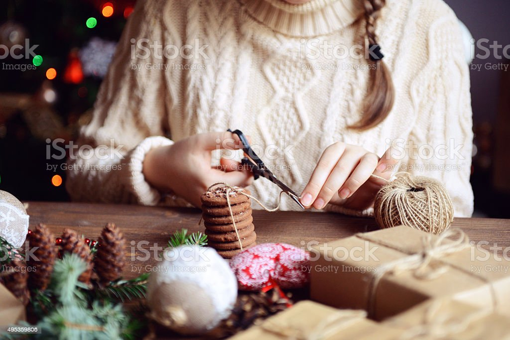 girl making Christmas presents stock photo