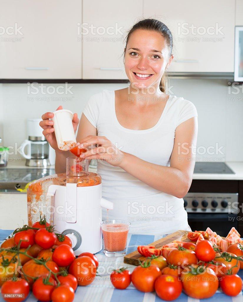 Girl making freshly squeezed juice royalty-free stock photo