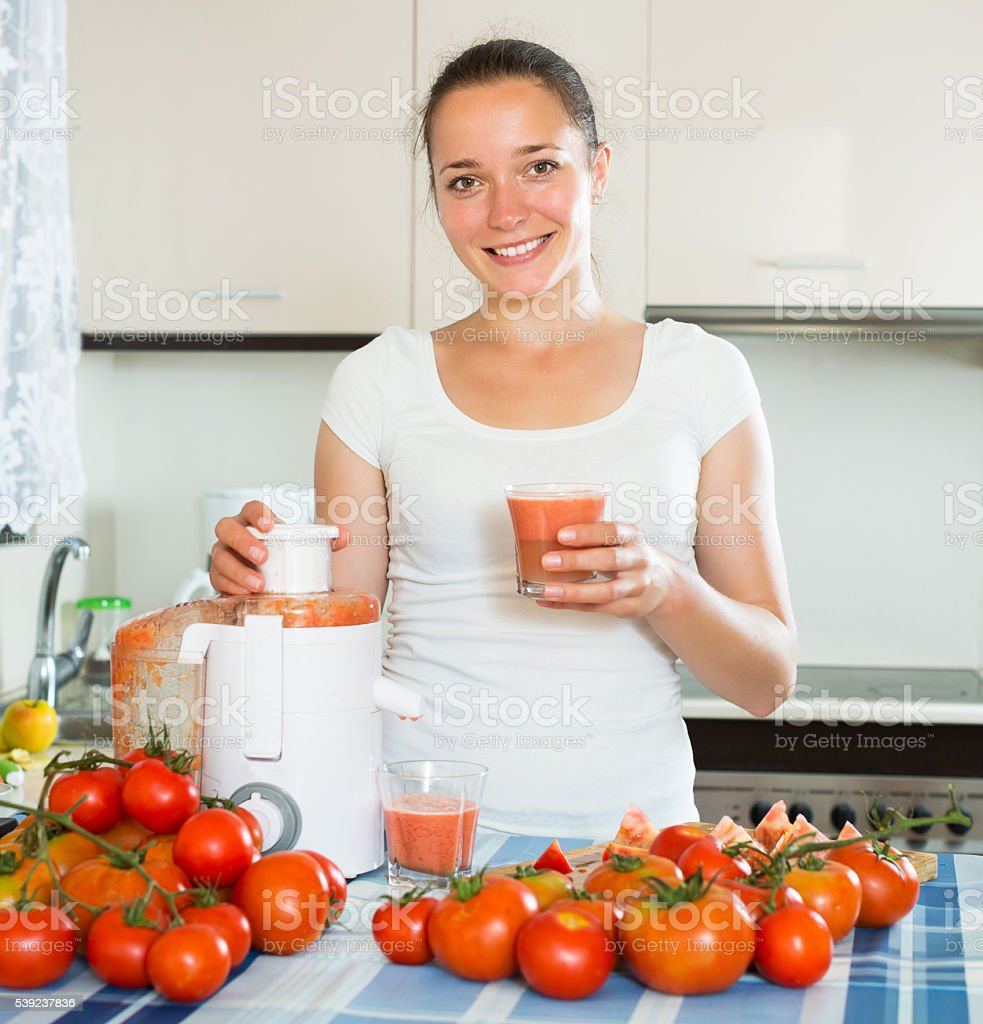 Girl making freshly squeezed juice royalty-free stock photo