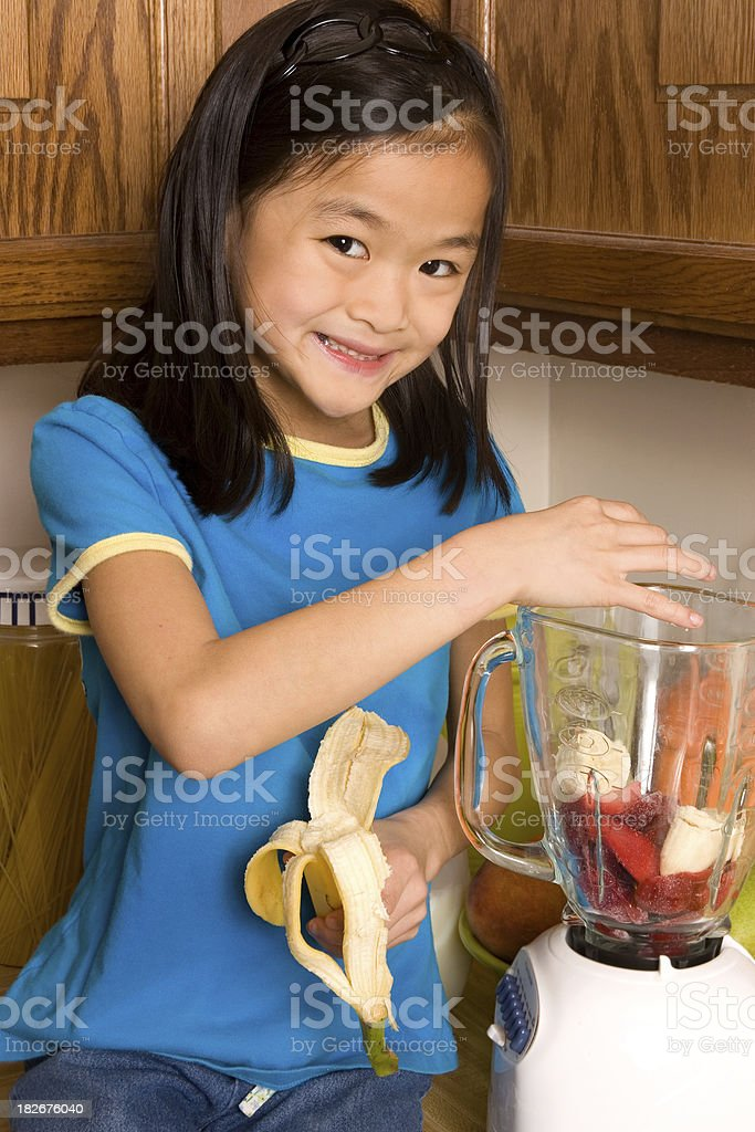 Girl making healthy smoothie (series) royalty-free stock photo