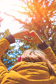 istock Girl making heart - shape symbol for love in the nature. 1041626796