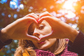 istock Girl making heart - shape symbol for love in the nature. 1041631242