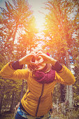 istock Girl making heart - shape symbol for love in the nature. 1043681450