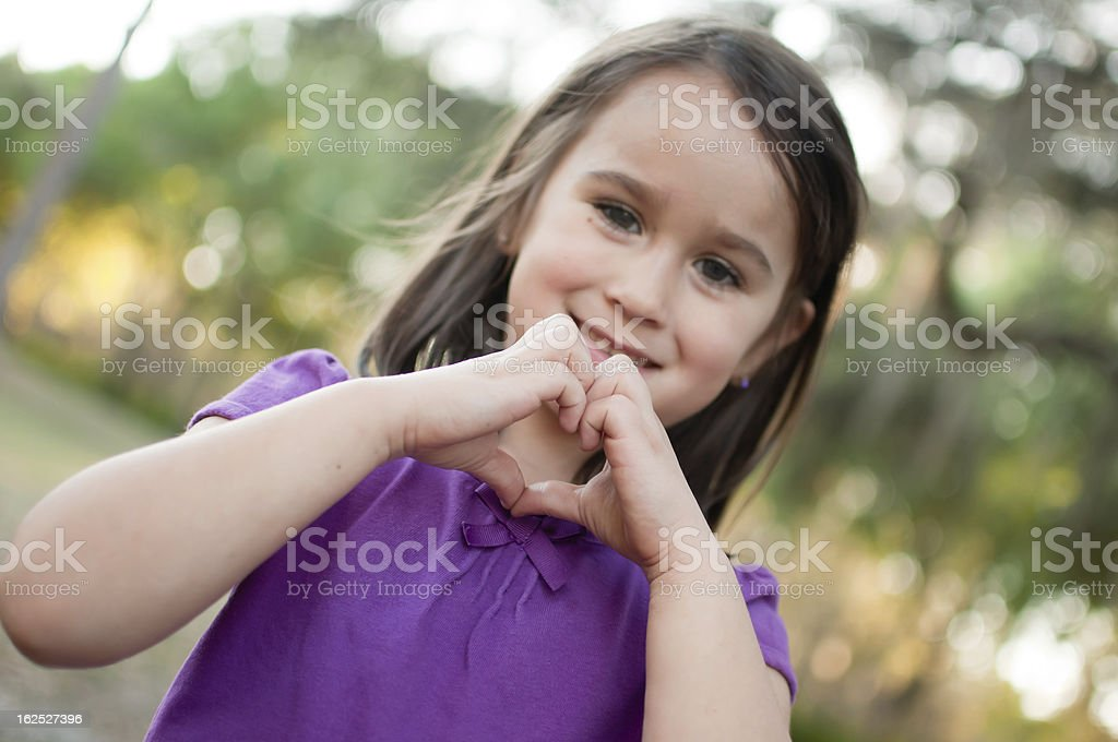 Girl Making Heart Sign royalty-free stock photo