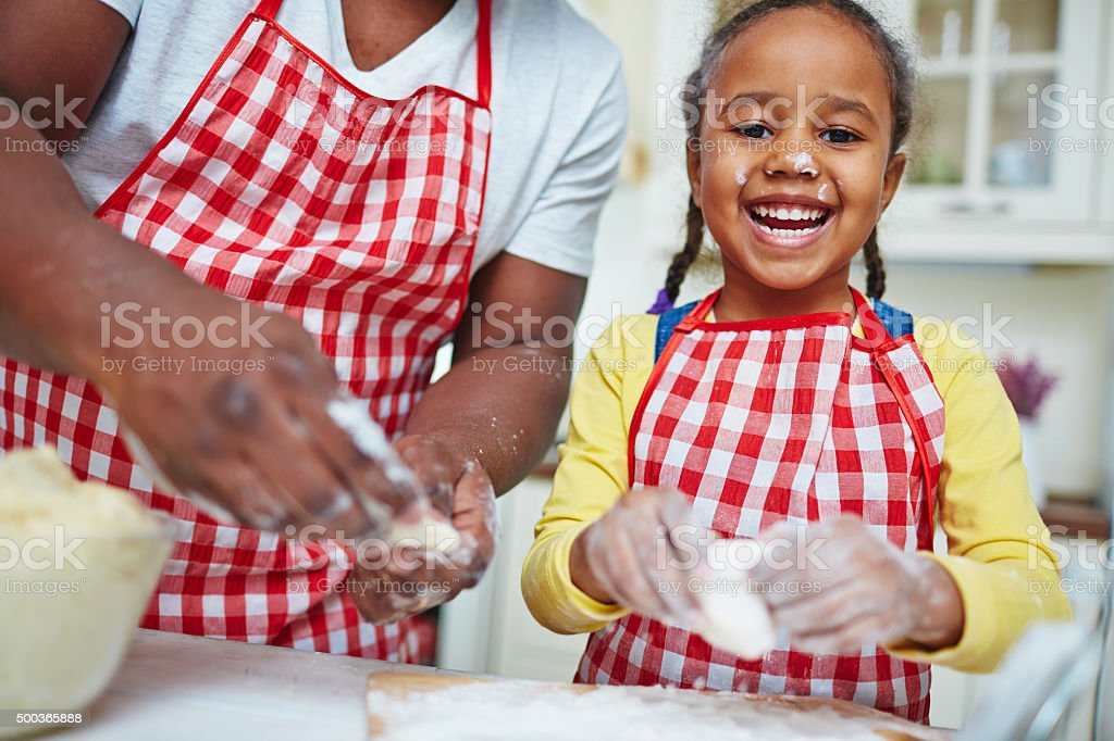 Girl making pastry stock photo