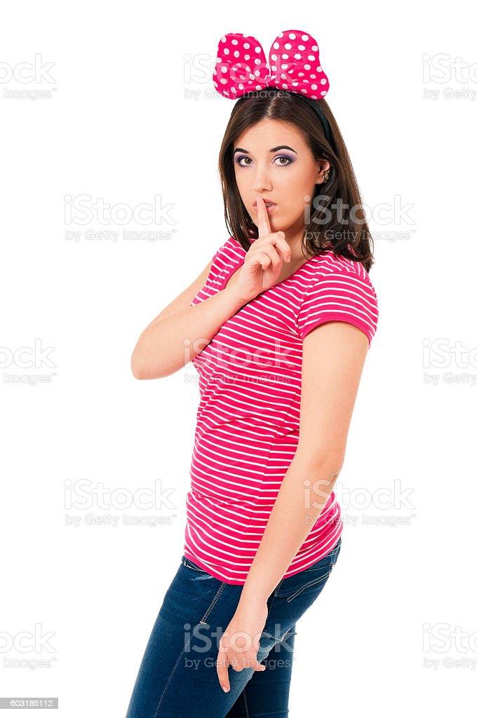 Girl making silence gesture stock photo