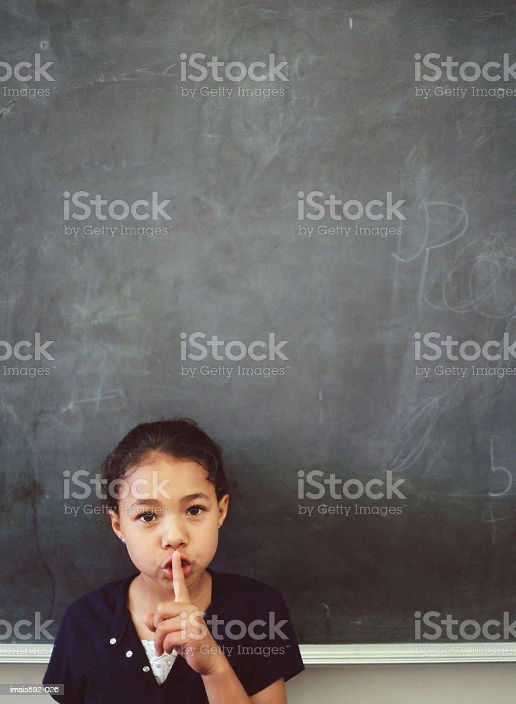 Girl making silence gesture royalty-free stock photo