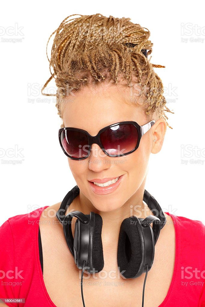 Girl many plaits hairstyle with headphones royalty-free stock photo