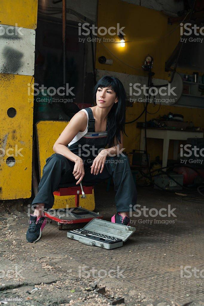 girl mechanic with tools stock photo