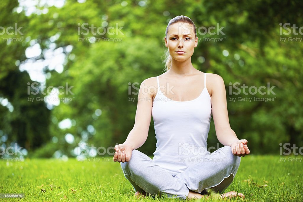 Girl meditates in nature royalty-free stock photo