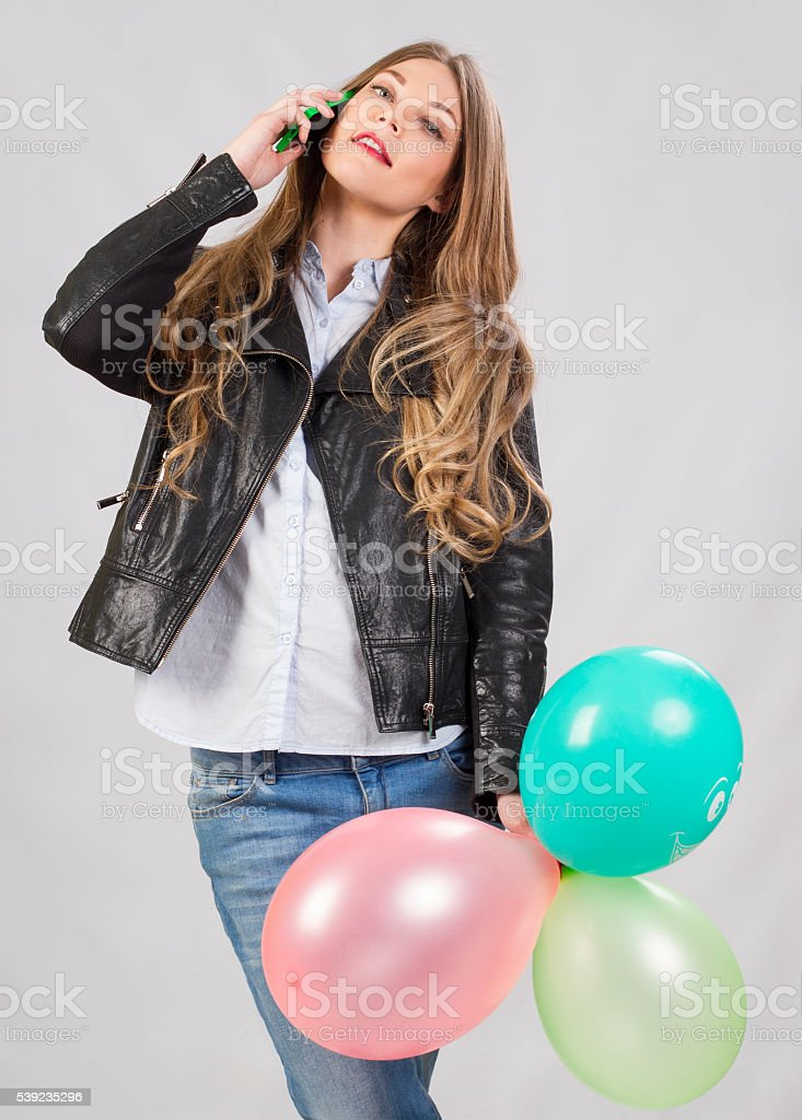 girl model in studio with balloons and cell phone royalty-free stock photo