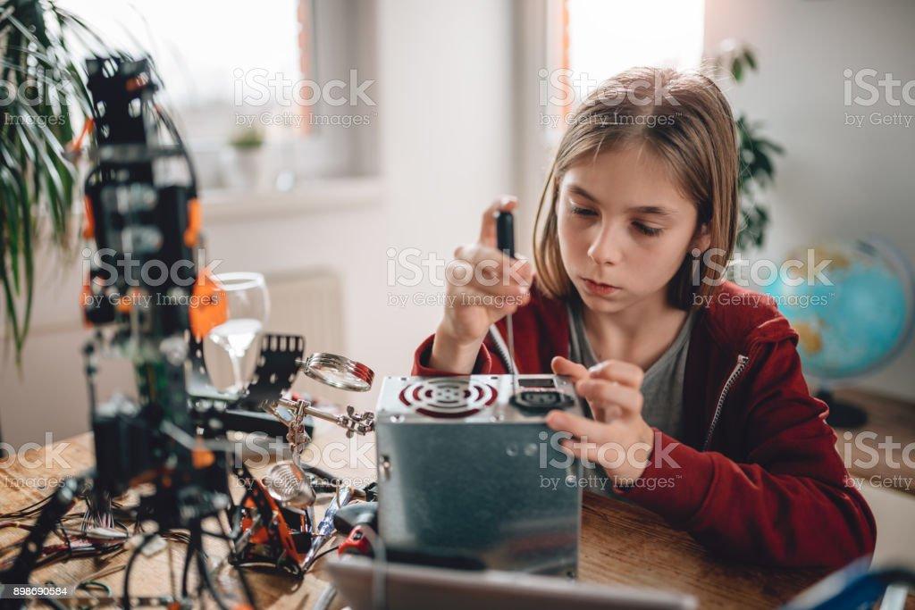 Girl modifying power supply and  learning robotics stock photo