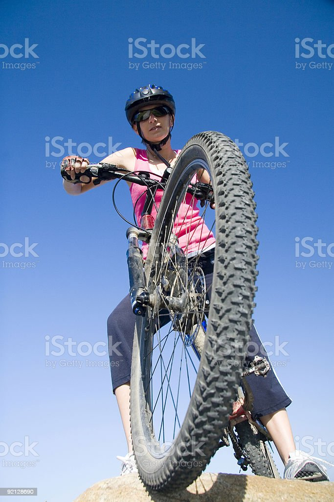 Girl moutain biking by the sea royalty-free stock photo