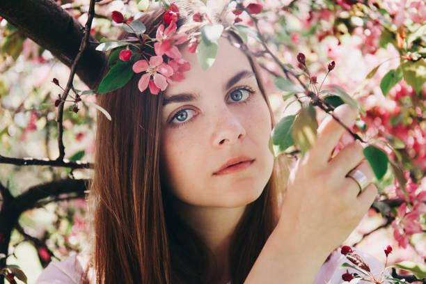 Girl near blossoming tree. stock photo