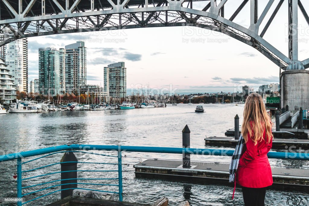 Girl near False Creek in Vancouver BC, Canada stock photo