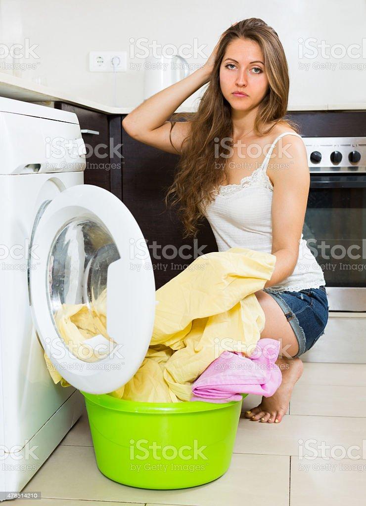 Girl near washing machine stock photo