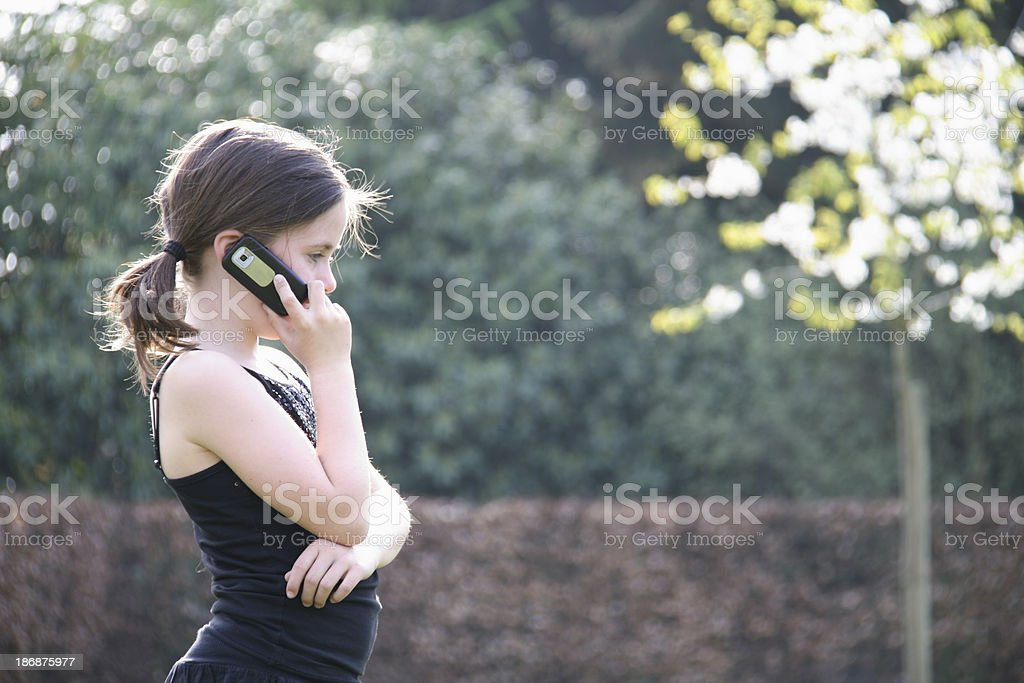 girl of 8 years old making a phone call stock photo