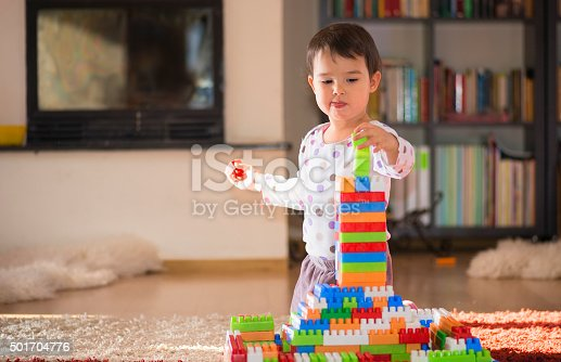 istock girl of preschool age playing with colorful blocks 501704776